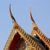 image of gable-roof  - gable apex on temple roof with blue sky background - JPG