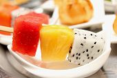 picture of fruit platter  - Platter of fruit skewers with a dish Healthy party food - JPG