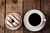 picture of donut  - donuts and coffee on the dark wood background toning - JPG