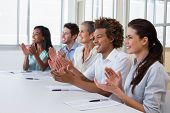picture of half-dressed  - Casual business team clapping at presentation in the office - JPG