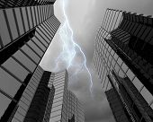 image of typhoon  - Bottom image of skyscraper with thunder lightning in sky - JPG