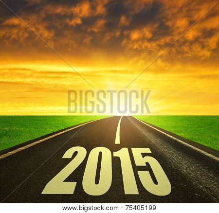 Asphalted road at sunset .Forward to the New Year 2015