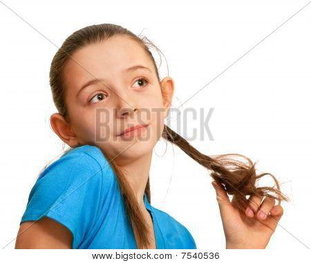 Portrait Of A Thoughtful Girl Playing With Her Hair