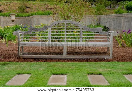 Wooden Bench In Iris Garden