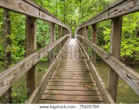 Wooden Footbridge Over River