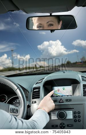 Woman Using Gps Navigator In A Car