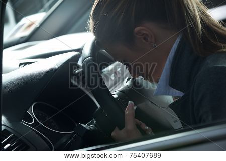 Depressed Woman In A Car