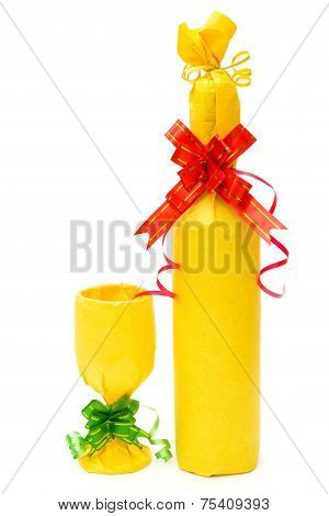 Wrapped Wine And Cup As Gifts On A White Background