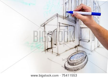 Man's hand creating a free drawing of a mansion in perspective on a whiteboard as rough sketch