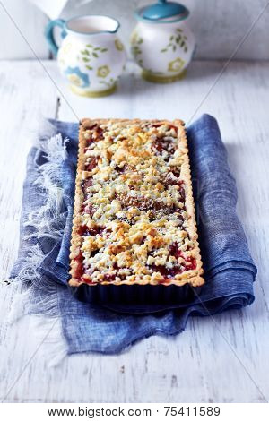 Shortcrust plum cake with coconut crumble