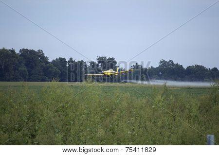 Yellow Crop Dusting Airplane Spraying Farm Field