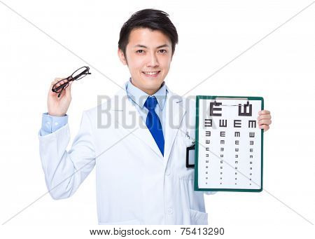 Optician hold with glasses and eye chart