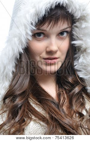 young womanwith long brown hair  in fur white hat. isolated on white