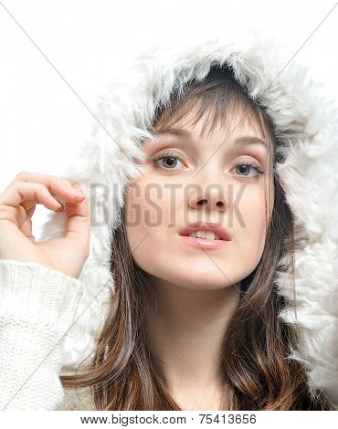 young woman with long brown hair  in fur white hat. isolated on white
