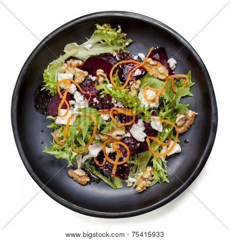 Beetroot salad with feta cheese, walnuts and carrot.  Isolated on white.