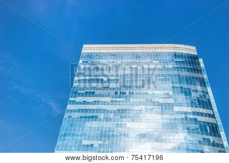 Modern Office Building Wall Made Of Steel And Glass With Blue Sky