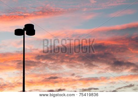 Lamppost Silhouette At Sunset