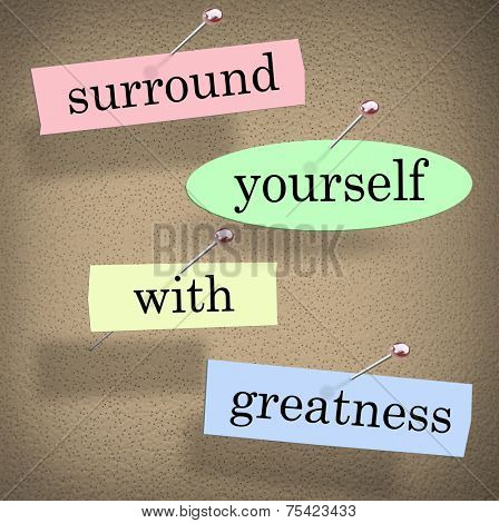 Surround Yourself with Greatness words in a saying or quote pinned to a bulletin board for motivation and inspiration