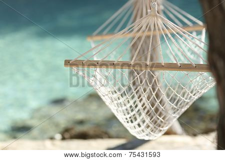 Tropical Beach Vacation Concept With A Hammock And Turquoise Water