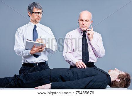 Clerks Repairing A Businessman For Fun