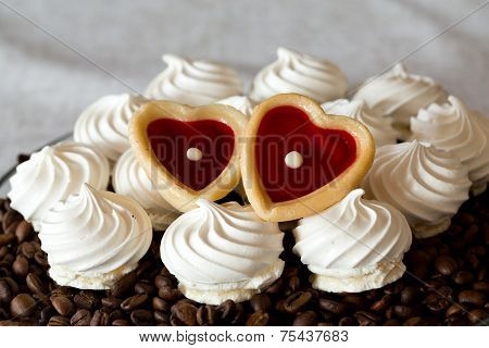 French vanilla meringue cookies and two sweet hearts