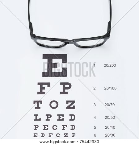 Eyesight Test Chart With Glasses Over It - Studio Shot