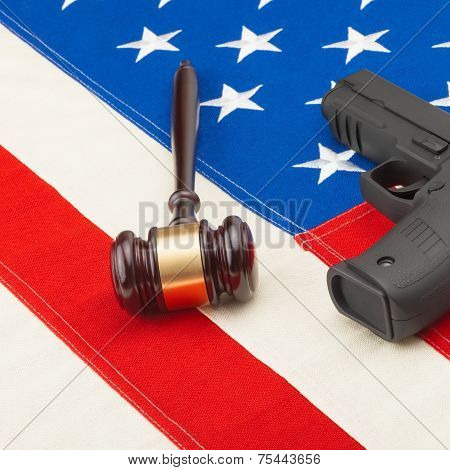 Wooden Judge Gavel And Gun Over Usa Flag - Studio Shot