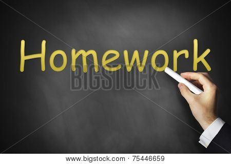 Hand Writing Homework On Chalkboard