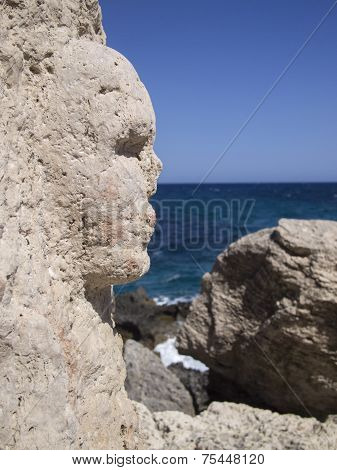 Face Sculpted On A Rock