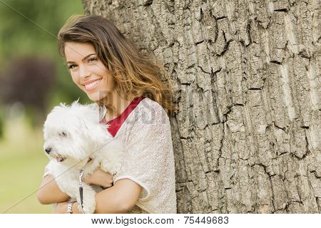Young Woman With A Dog