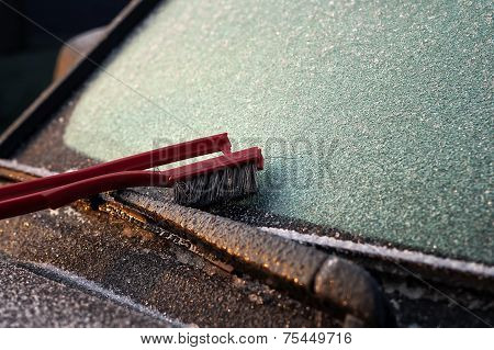 Ice Scrapper On The Windscreen