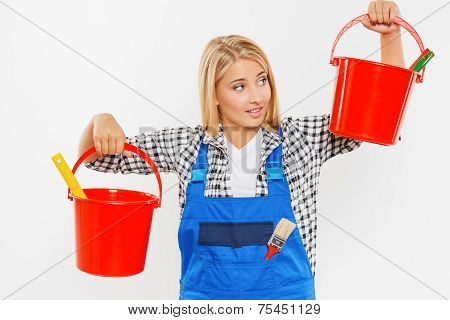 Young woman holding buckets with paint