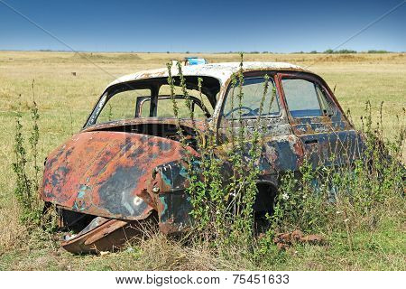 Wreck car in a field