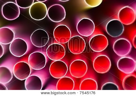 A Closeup Of Drinking Straws In The Colors Orange, Red, Rounds Form.
