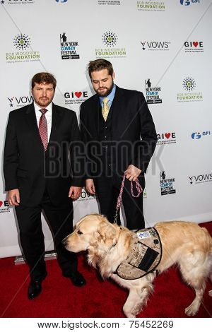 NEW YORK, NY - NOVEMBER 05: (L-R) Jake Young, Marshall Peters, Petty Officer 3rd Officer, US Navy, Veteran, and Service Dog Lundy attend  Stand Up For Heroes  November 5, 2014 in New York City