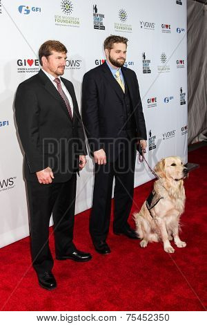 NEW YORK, NY - NOVEMBER 05: (L-R) Jake Young, Marshall Peters  and Service Dog Lundy attend 2014 Stand Up For Heroes at Madison Square Garden on November 5, 2014 in New York City
