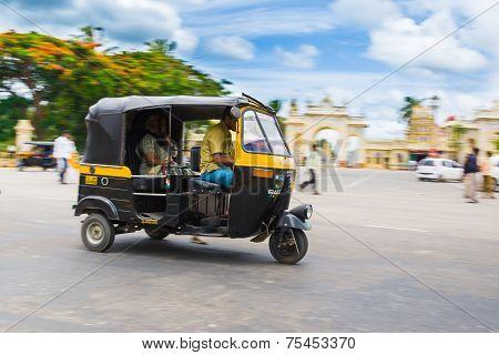 Auto Rickshaw in front of Mysore Palace.