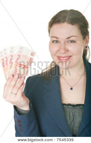 The Beautiful Girl Holds Cash In A Hand. Isolated On White Background.