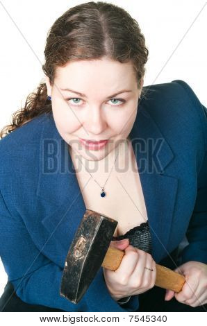 The Young Beautiful Girl With A Hammer In Hands. It Is Isolated On A White Background
