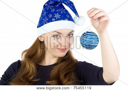 Portrait of young woman with christmas balls