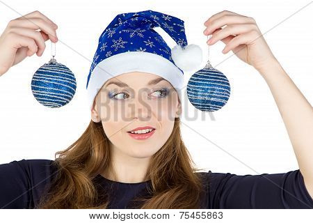 Image of young woman looking at christmas balls