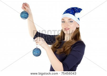 Portrait of woman with christmas balls in hat