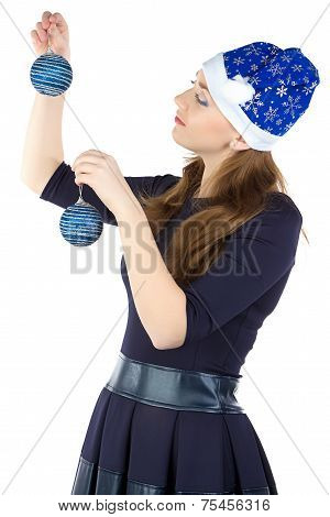 Image of woman decorating wall with balls