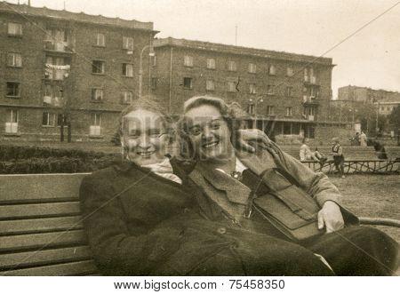 LODZ, POLAND, CIRCA FIFTIES: Vintage photo of two women on bench