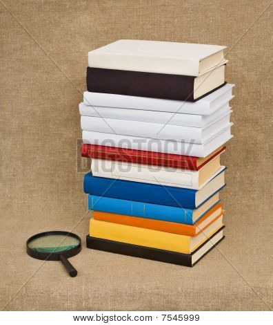 Pile Of Books And Magnifying Glass - Educational Still Life