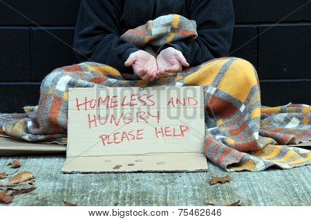 Homeless man begging