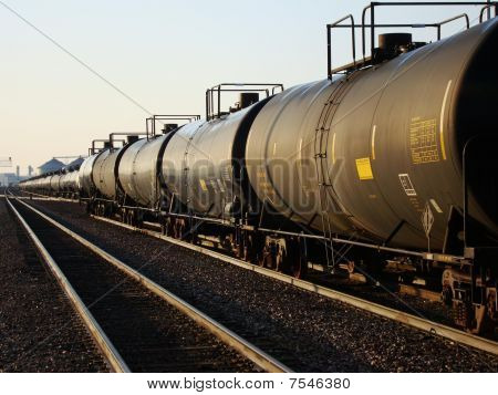 Railroad tank cars at sunrise