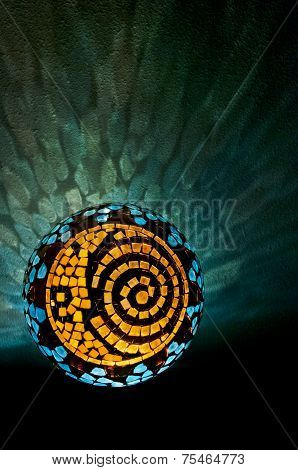 Mosaic lighted ball with sun, moon and spiral design in vertical position