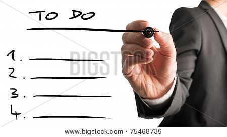 Businessman Drawing Up A To Do List