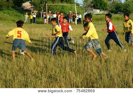 Asian Kid Playing Football, Physical Education